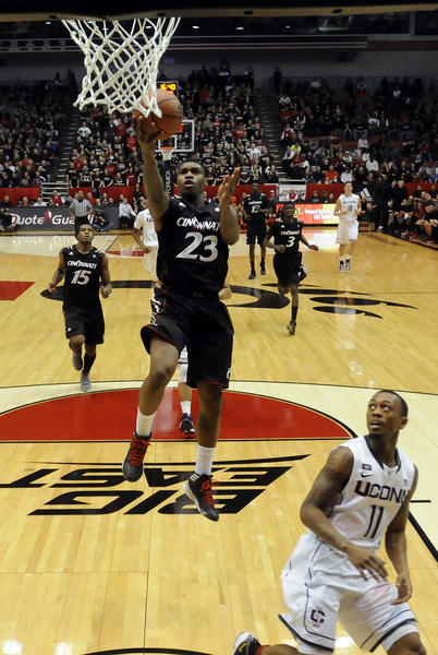 Cincinnati Bearcats guard Sean Kilpatrick drives past UConn's Ryan Boatright. Kilpatrick scored 20 points to help Cincinnati beat the Huskies 61-56 at the Fifth Third Arena in Cincinnati Saturday afternoon.