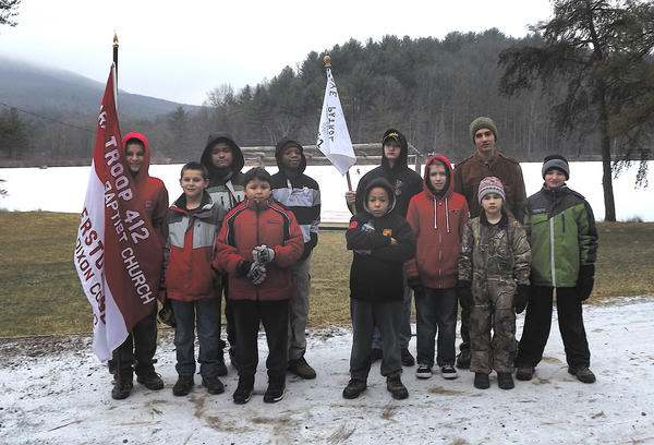 Back row, from left, Kevin Macias, Kole Faokunla, Aaron Haden (holding flag), Logan Toms and Braydon Strausser. Front row, Ryan Maguire (holding flag), Sean Maguire, Joshua Macias, Devonte Johnson, Landon Strausser and Holden Strausser The leaders are, not pictured, Bill Taylor, scoutmaster; Michele Taylor and Noel Macias, assistant scoutmasters.