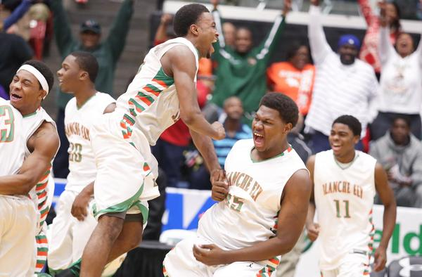 Blanche Ely players celebrate after winning the Class 7A championship.