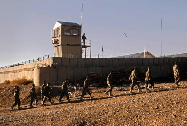 Forward Operating Base Naghlu, in Surobi, Afghanistan, is one of hundreds of bases, checkpoints, guard towers and other outposts the U.S.-led coalition must either dismantle or hand over to Afghan forces. Afghan officials have objected to U.S. decisions to raze some bases.