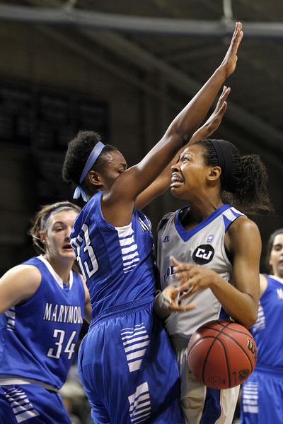 Christopher Newport University's Tia Perry, right, loses control the ball to the defense of Marymount University's Tynisha Parks during Saturday's second round Division III NCAA tournament game.