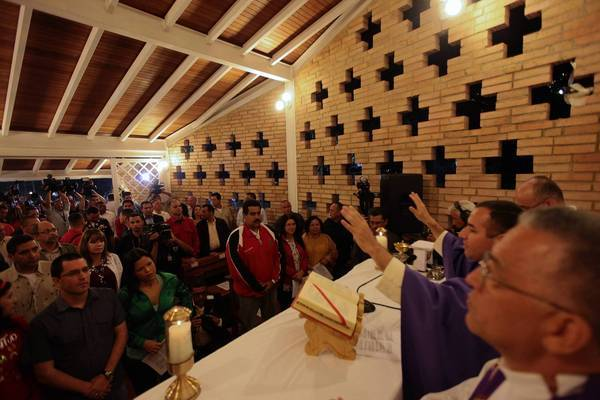 A Mass is held Friday to pray for Hugo Chavez's health at a chapel in the military hospital where the Venezuelan president is being treated in Caracas.