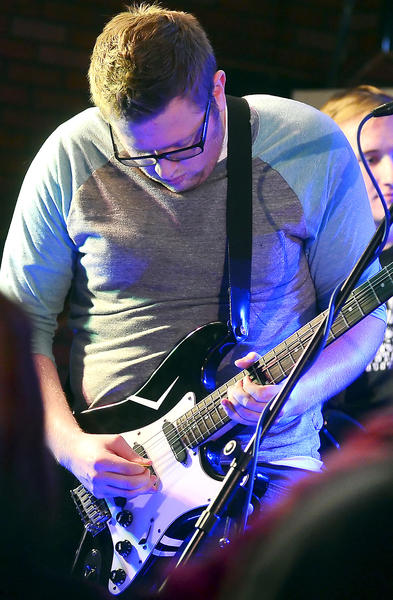 Seth Decker, Shouting Whispers' lead vocalist and rhythm guitarist, plays guitar during their set during Bridgefest 13 at Bridge of Life Church in Hagerstown Saturday.