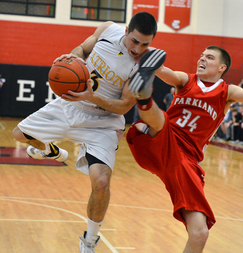 Parkland's Astin Jones (34) battles against Freedom's Brian Uliana (3) in the District 11 4A boys basketball championship game at Easton Area Middle School on Saturday. .