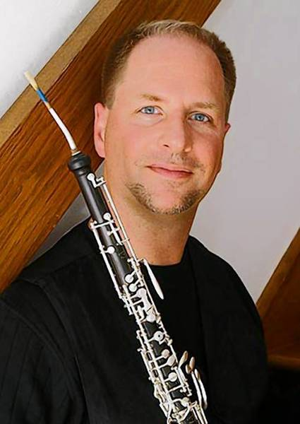 George Corbett, English horn player with the Virginia Symphony, will bge soloist in concerts March 7 in Williamsburg and March 9 in Virginia Beach