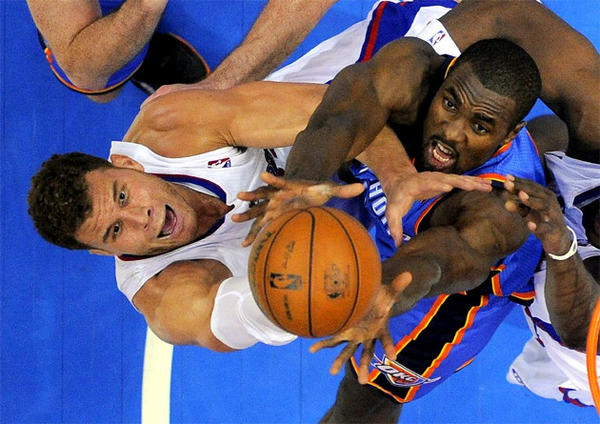Clippers forward Blake Griffin, left, and Oklahoma City Thunder forward Serge Ibaka battle for a rebound.