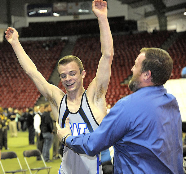 Williamsport's Nick Miller raises his arms while in the grasp of head coach Mike Rechtorovic after winning the Maryland Class 2A-1A state title at 106 pounds on Saturday at the Maryland State Tournament in College Park, Md.