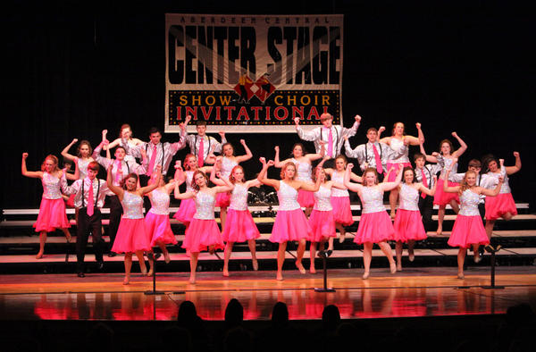 Prismatic Sensations, of Groton, perform Saturday at the Center Stage Show Choir Invitational at Aberdeen Central High School. The day-long event featured show choirs from nine schools. American News Photo by John Davis
