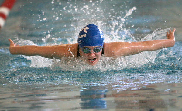 Molly Hogg, of the Aberdeen Swim Club, competes in the girls 13 and over 400 yard individual medley Saturday at the South Dakota Short Course State Swim Meet at the Aberdeen Family YMCA. photo by john davis taken 3/2/2013