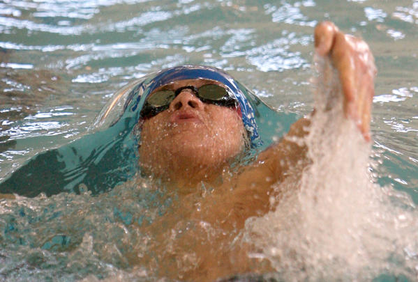 Tucker Iwerks, of the Aberdeen Swim Club, competes in the boys 13 and over 400 yard individual medley Saturday at the South Dakota Short Course State Swim Meet at the Aberdeen Family YMCA. photo by john davis taken 3/2/2013