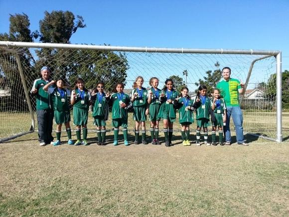 The Costa Mesa Mean Green Machine, a girls' 10-and-under team, won the Gold Division of the Costa Mesa Classic.
