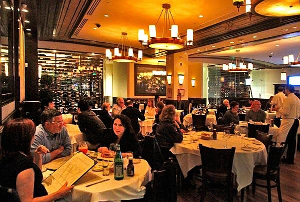 Widely spaced tables and oversized lighting fixtures are features at Wolfgang's Steakhouse.