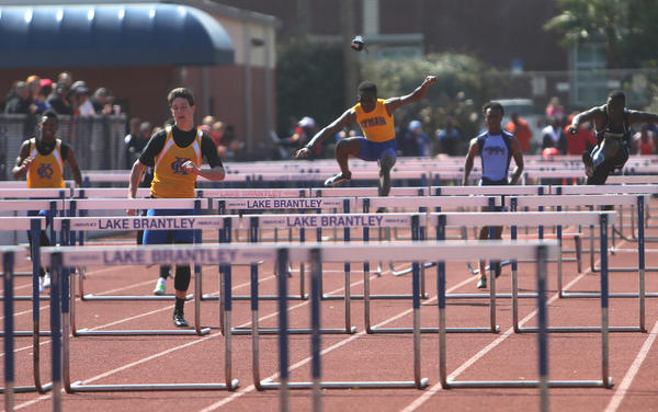 Lyman High School athlete Jason Campbell has his shoe fly off during the 110 Hurdles event at the 2013 Lake Brantley Invitational track meet at Lake Brantley High School in Altamonte Springs, Florida on Saturday, March 3, 2013.  (Cassie Armstrong, Orlando Sentinel)