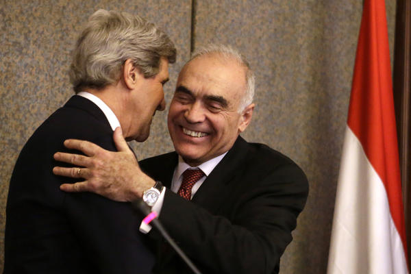 U.S. Secretary of State John Kerry embraces Egyptian Foreign Minister Kamel Amr after their news conference at the Ministry of Foreign Affairs.