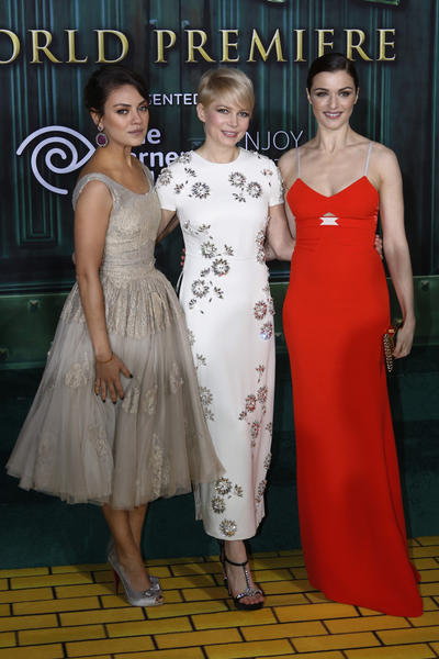 "Actresses Mila Kunis, Michelle Williams and Rachel Weisz arrive at the premiere of the Disney movie ""Oz the Great and Powerful"" at the El Capitan Theatre in Hollywood, Calif."