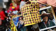 Souvenirs bearing images of Venezuela's President Hugo Chavez are on sale during a rally in Caracas