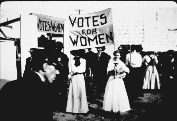 "Women demnstrate for the right to vote in a ""Votes for Women"" suffrage parade in Hartford in 1915."