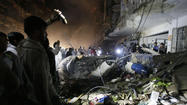 ISLAMABAD, Pakistan — At least 30 people were killed and dozens injured Sunday when either one or two bombs exploded in a Shiite-majority neighborhood of Karachi, local officials said.