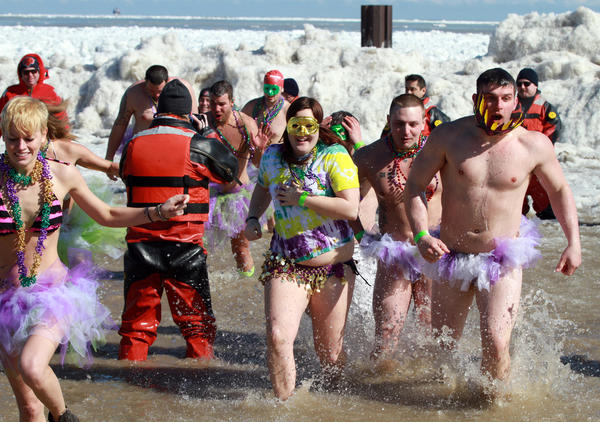 Well over 1,000 people, most wearing costumes, braved the 32-degree water temperature at North Avenue beach to benefit the Chicago Special Olympics on Sunday in Chicago.