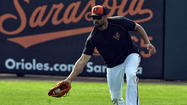 Orioles right fielder Nick Markakis was scratched from the starting lineup for Sunday afternoon's Grapefruit League game against the Phillies after he woke up with neck spasms.