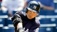 New York Yankees Ichiro Suzuki hits a single in the first inning of their MLB baseball spring training game against the Toronto Blue Jays in Tampa