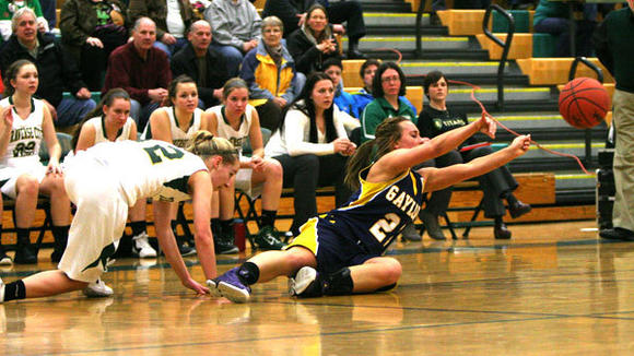 Gaylord senior Sarah Polena makes a play from the floor during Friday's victory over TC West.