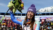 Tina Maze, a 29-year-old Slovenian skier who has clinched the World Cup overall women's title this season, shook off a death threat to finish fourth in the super-giant slalom race Sunday in Garmisch-Partenkirchen, Germany.