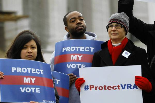Voting rights activists gather in front of the U.S. Supreme Court in Washington Feb. 27.