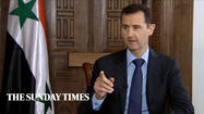 BEIRUT — Syrian rebels must give up their weapons before the government will agree to hold peace talks with them, Syrian President Bashar Assad said in a newspaper interview published Sunday.