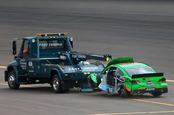 Danica Patrick's No. 10 GoDaddy.com Chevrolet is towed off the track after a wreck during the NASCAR Sprint Cup Series race Sunday at Phoenix International Raceway.