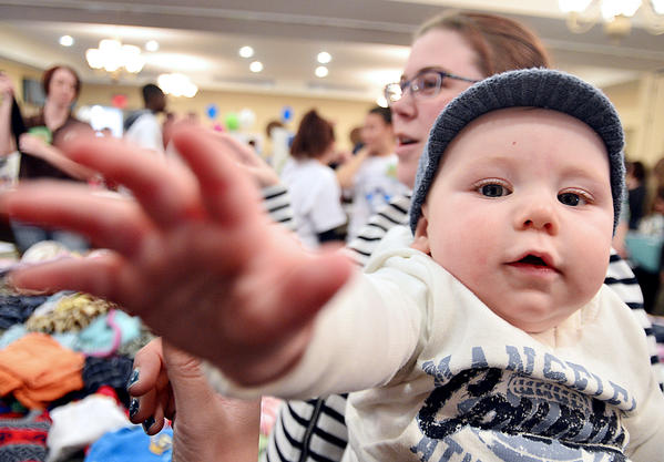Mattingly Golden, 7 months, and his mother, Jessica Golden, of Hagerstown sort through clothes at the baby clothing swap Sunday at the Birth and Babies Fair, sponsored by Hagerstown Regional Childbirth Resources at Homewood Suites by Hilton Hotel in Hagerstown.