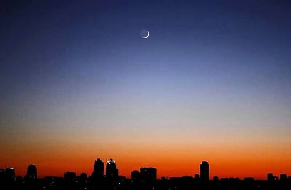 A crescent moon is seen over Buenos Aires at sunrise