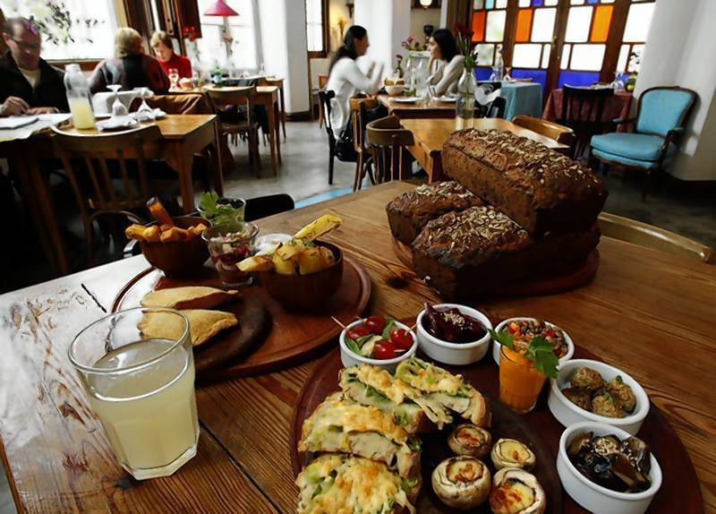 A selection of vegetable-based dishes, ranging from corn and mushroom tapas to a more classic assortment of olive, lentil, cheese, garlic and beetroot tapas, on offer at vegetarian restaurant Artemisia in Buenos Aires.