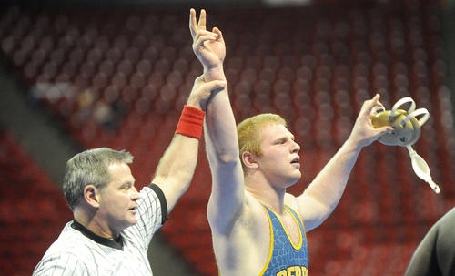 Matt Green of Perry Hall has his arm raise in victory after beating his opponent Dalonte Holland of Huntingtown in the championship match of the 4A/3A 285 pound weight class during the 2013 Maryland State Wrestling Tournament at the University of Maryland's Cole Field House in College Park, Md. on Saturday, March 2, 2013.