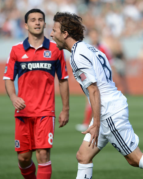 Galaxy forward Mike Magee celebrates a goal during the first half against the Fire at The Home Depot Center.