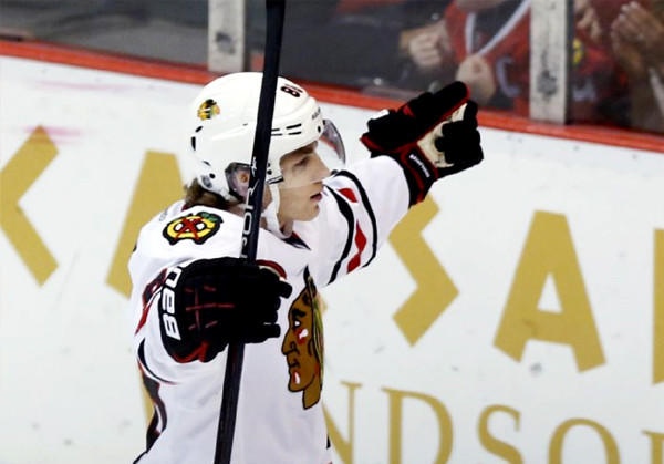 Blackhawks winger Patrick Kane celebrates his shootout goal to defeat the Detroit Red Wings.