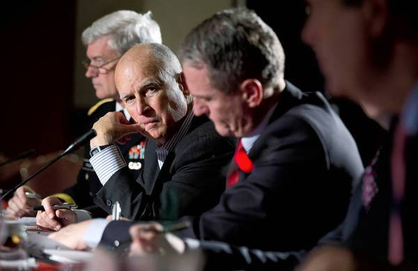 Gov. Jerry Brown, center, attends a panel discussion on extreme weather at the National Governors Assn. meeting in Washington. He is urging other states to pursue California-style environmental policies.