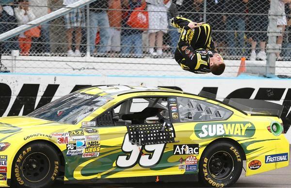 Carl Edwards does a backflip after winning the Subway Fresh Fit 500 at Phoenix International Raceway.