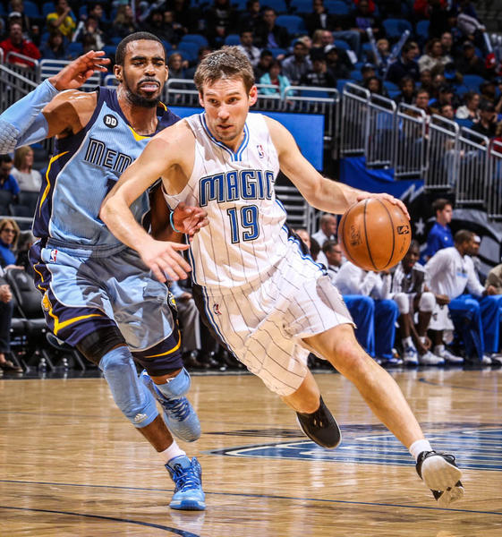 Magic guard Beno Udrih (19)  drives against Memphis' Mike Conley (11) during third quarter action of a game against the Memphis Grizzlies at Amway Center in Orlando, Fla. on Sunday, March 03, 2013. (Joshua C. Cruey/Orlando Sentinel)