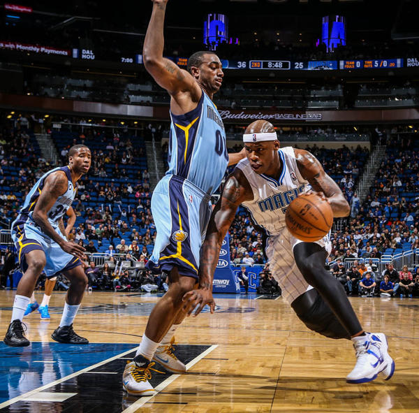 Magic forward Al Harrington (3) drives against Memphis' Darrell Arthur (00) during second quarter action of a game against the Memphis Grizzlies at Amway Center in Orlando, Fla. on Sunday, March 03, 2013. (Joshua C. Cruey/Orlando Sentinel)
