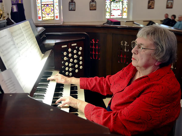 "Kathy Ott, a member of the Chambersburg, Pa., chapter of the American Guild of Organists, plays ""Improvisation on an Irish Air"" Sunday during the Pipes Spectacular performance at Zion Reformed Church in Chambersburg."