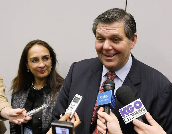 Jim Brulte speaks with reporters after being elected state Republican Party chairman Sunday. With him is Harmeet Dhillon, the new vice chair.