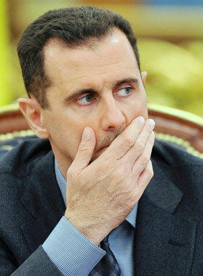 Syrian President Bashar Assad, in a rare interview with a Western newspaper, told Britain's Sunday Times that he will negotiate with rebels only if they give up their arms.