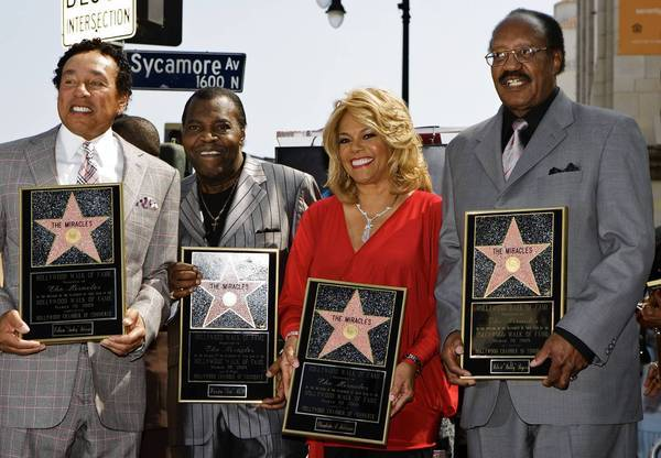 Bobby Rogers, right, with Smokey Robinson, left, Pete Moore and Claudette Robinson