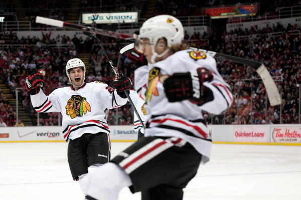 Blackhawks forward Patrick Kane (right) celebrates his goal with teammate Brandon Saad during the third period against Detroit on Sunday.