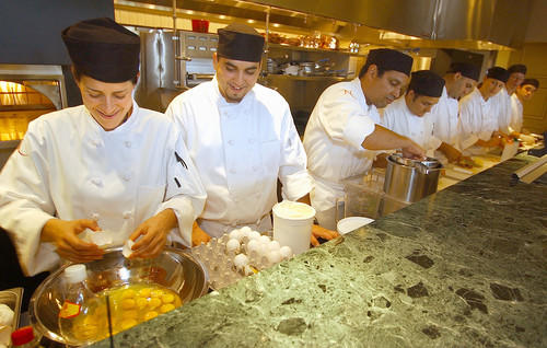 Chefs 7 deep in line give Viviana Altesor, 30, (far left) all the help she could ask while preparing for the 2003 opening of Norman's restaurant at the Ritz-Carlton Orlando.