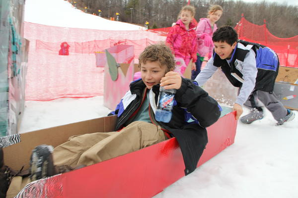 Hunter Zeytoonjian, 10, and Brian Namnoum, 10 of West Hartford test out their cardboard box sled before the start of the race at Mount Southington Saturday afternoon.