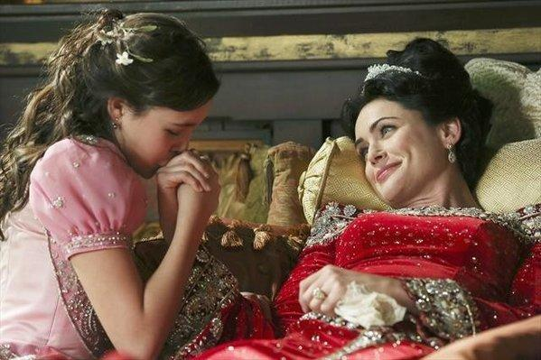 "Snow White (Bailee Madison) tends to her ailing mother (Rena Sofer) on the show ""Once Upon a Time."""