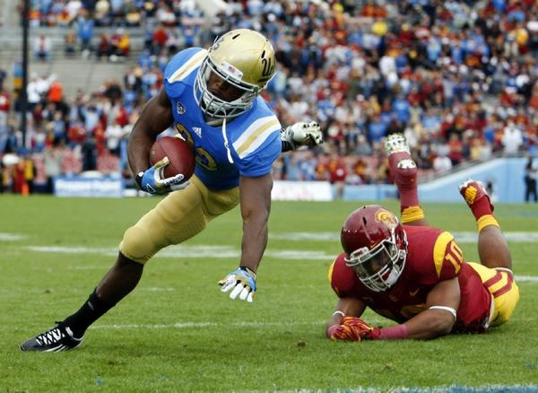 "UCLA running back Johnathan Franklin tries to stretch into the end zone against USC linebacker Hayes Pullard. The Bruins defeated the Trojans, 38-28. <a href=""http://www.lasports.org"">www.lasports.org</a>."