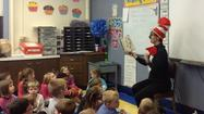 Dr. Seuss (alias Mrs. Karen Kraus) reads selections from the Dr. Seuss collection to Immanuel Lutheran School's second grade children.